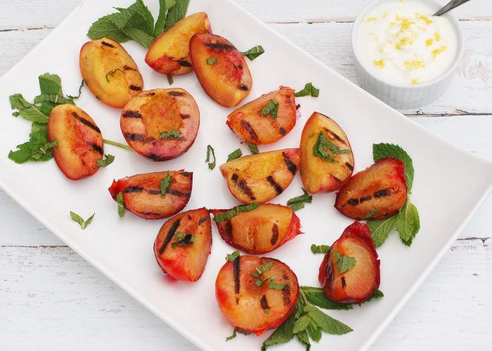 Grilled fruit on a white plate