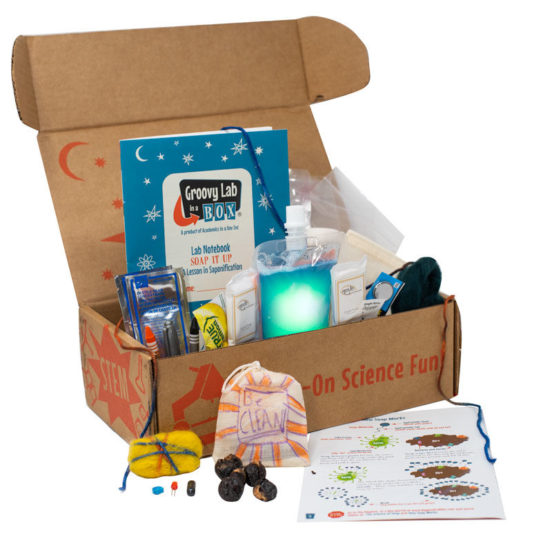 A cardboard box from the Groovy Lab in a Box company with various lab kits