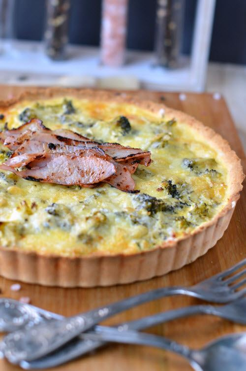 Homemade quiche with bacon and a crust.