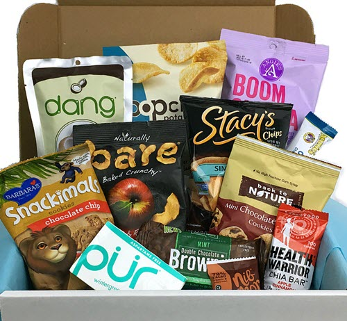 A white box with a selection of healthy snacks