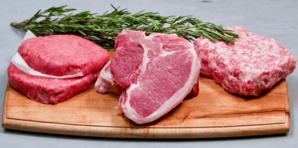 Raw meat with herbs on a chopping board