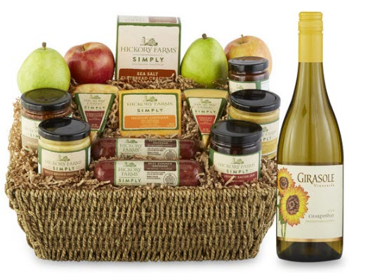 Cane basket with cheese, spreads and fruit.