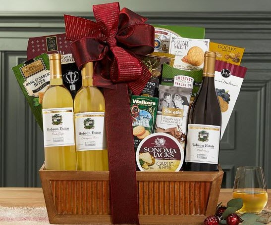 Wooden gift basket with various snacks and a red bow