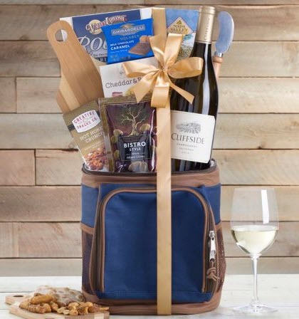 A cooler bag that contains wine and snacks