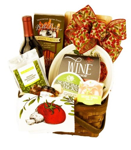 Cane basket with wine, cheese and snacks