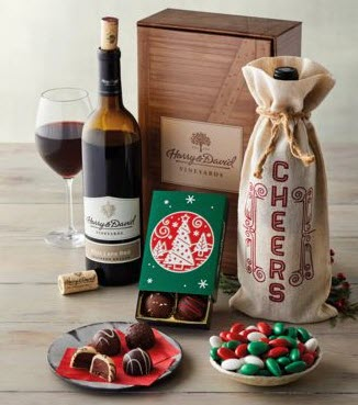 A simple box with a bottle of wine, truffles and chocolate