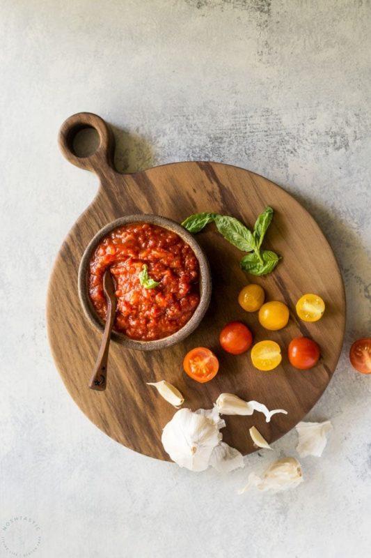 A bowl of marinara sauce with tomatoes