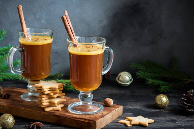 Two glasses containing hot buttered rum
