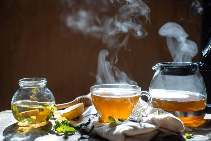 Hot tea in a mug and a tea pot