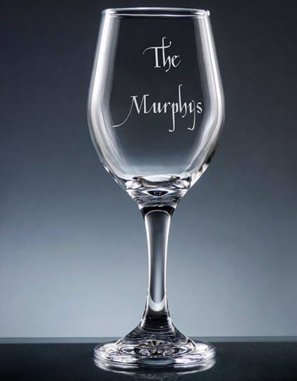 Wine glass with The Murphys engraved on it.