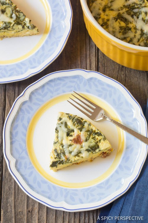 A piece of quiche on a plate with others in the background.