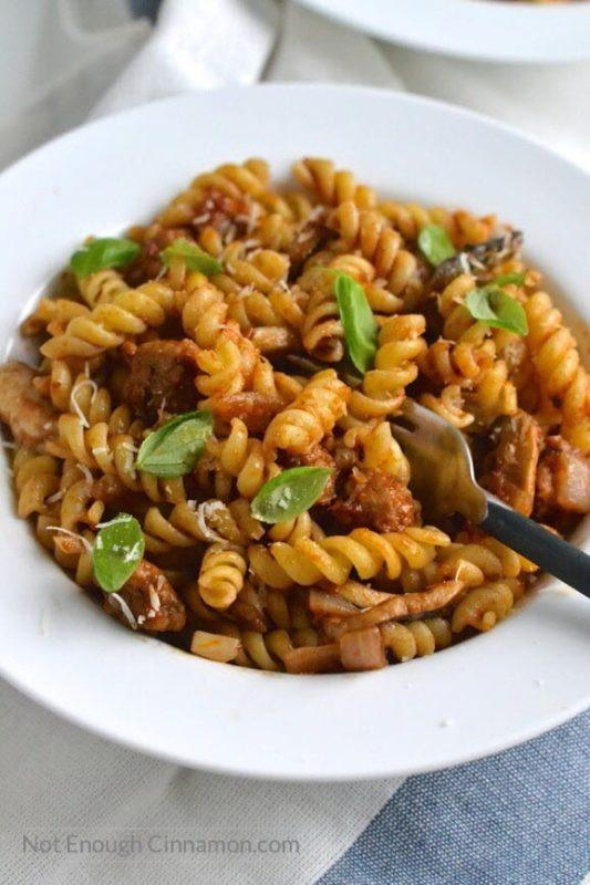 A bowl of pasta with sausage