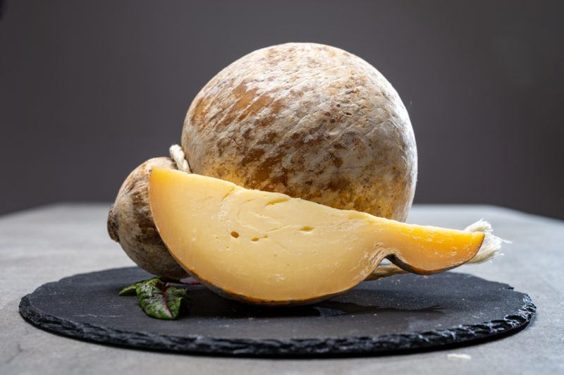 Italian semi hard matured caciocavallo cheese, handmade and aged in natural underground caves in Apulia region