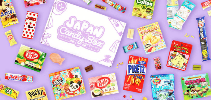 Selection of Japanese candies and a box against a purple background