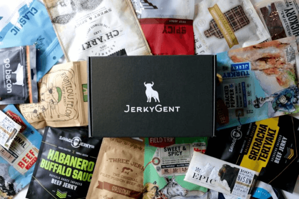 A JerkyGent subscription box on top of a wide selection of jerky