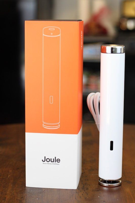 Joule standing next to open box