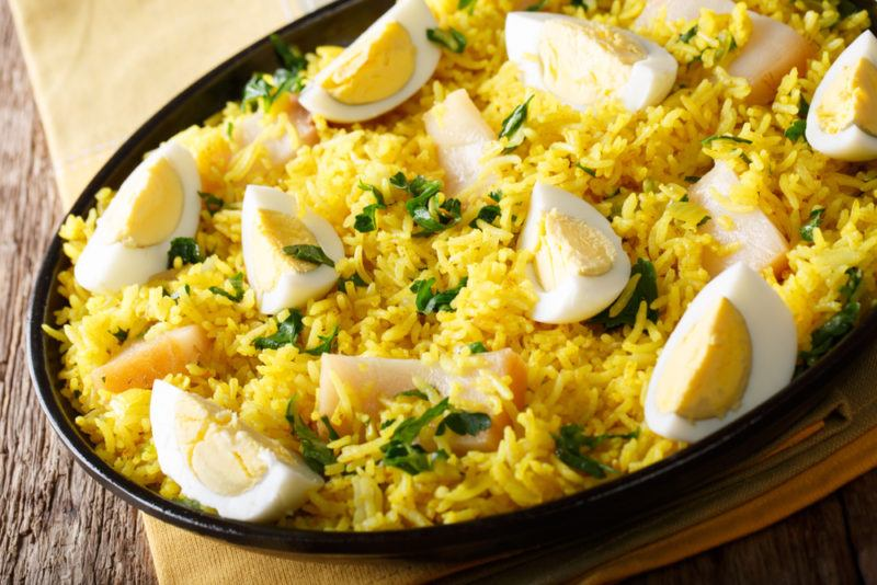 Kedgeree in a bowl. The meal includes rice, Indian spices, eggs and smoked fish
