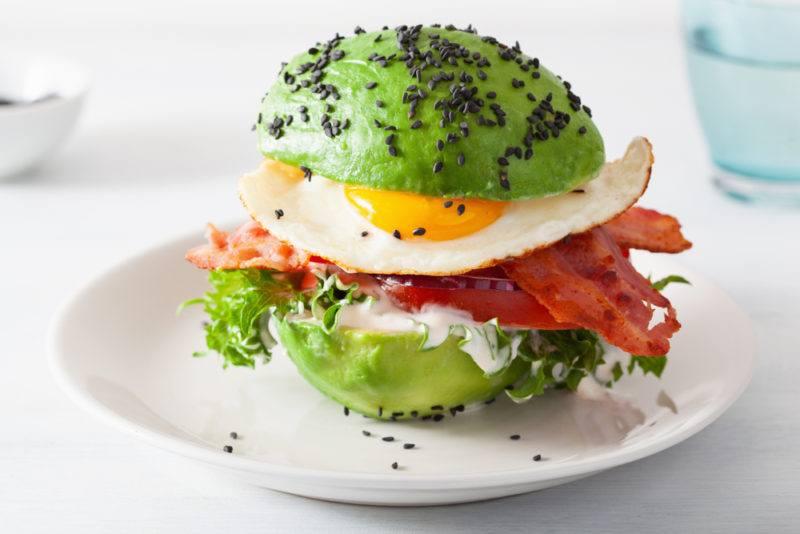 A keto burger made with avocado, eggs and bacon