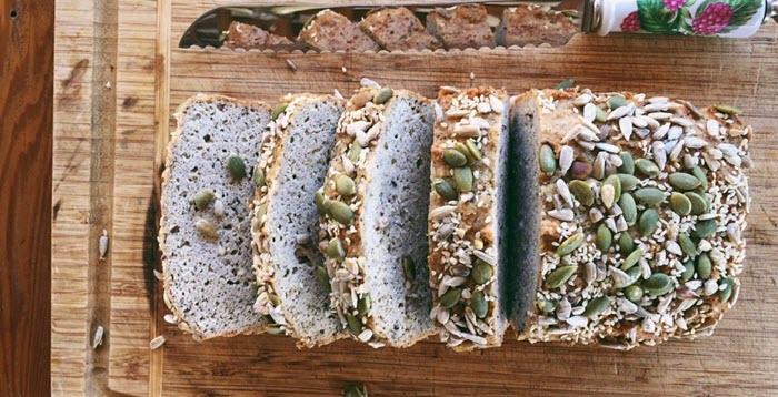 Seeded keto cauliflower bread on a board