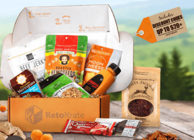 A Keto Krate on a table outside containing a wide selection of snacks.