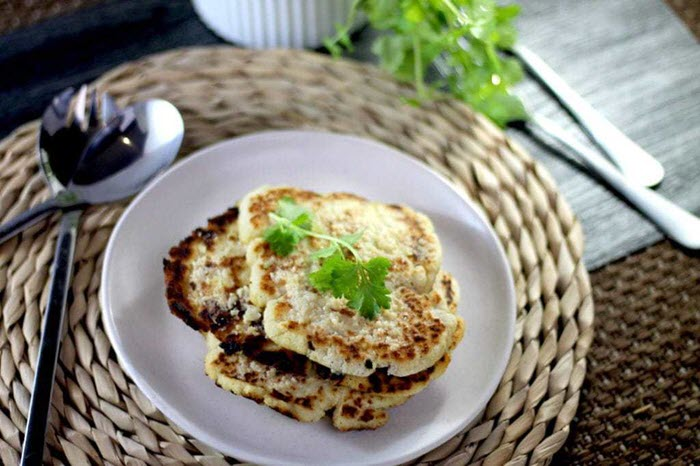 A small stack of naan bread on a white plate