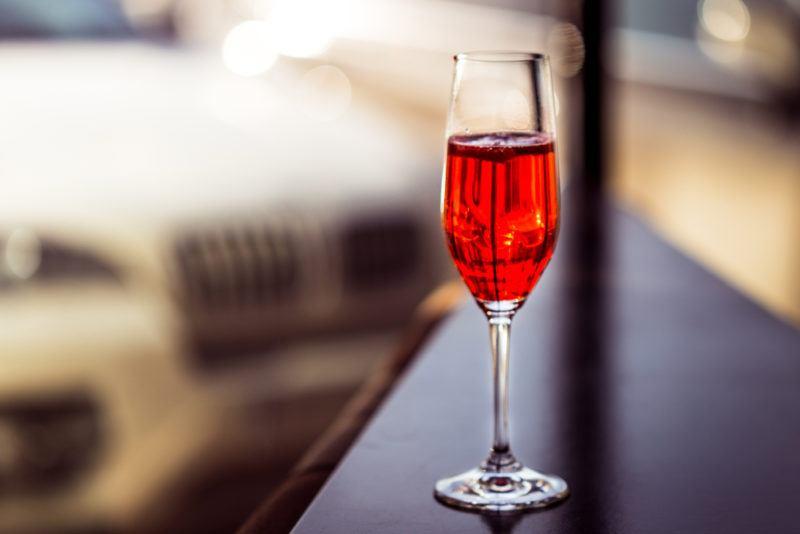 A Kir cocktail on a bar