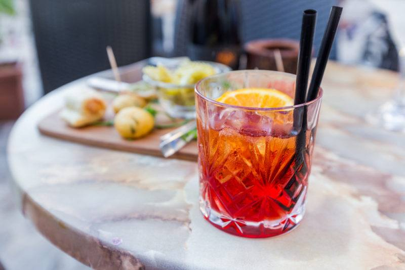 A red La Rosita cocktail on a marble tail