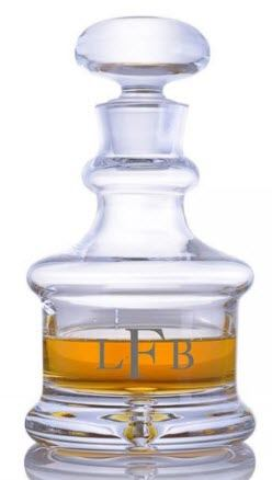 A squat decanter with the letters LFB engraved