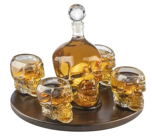 A skull decanter with four skull glasses