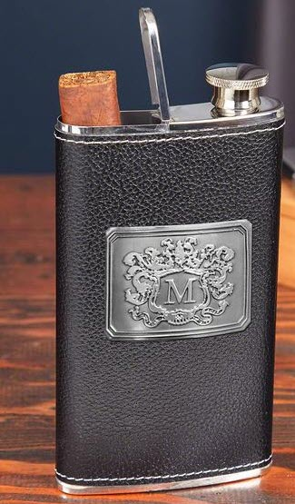 A black leather flask with a silver monogram on the front that also holds cigars