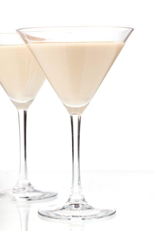 Two cream cocktails in martini glasses