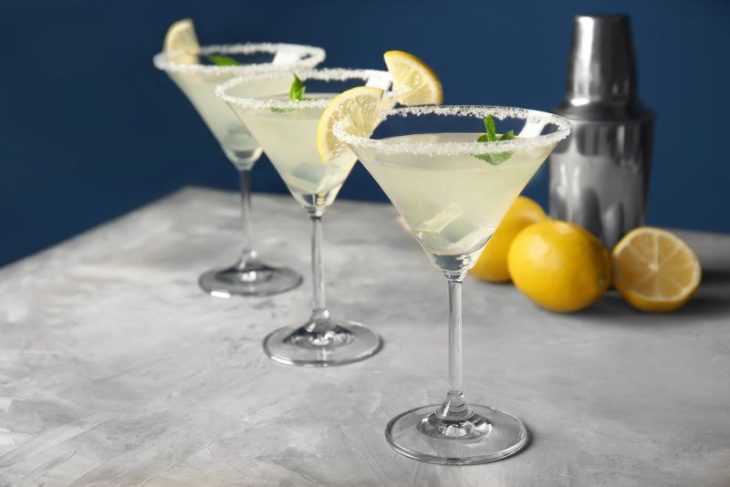 Three lemon drop cocktails served in martini glasses