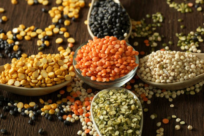 Spoons or small bowls contaiing different colors of lentils