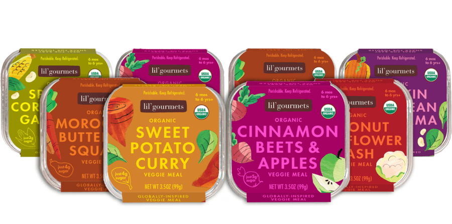8 packages of baby food lined up in three rows, the front two sweet potato curry and the other cinnamon beets and apples