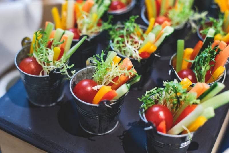 Little pails filled with vegetables and dips