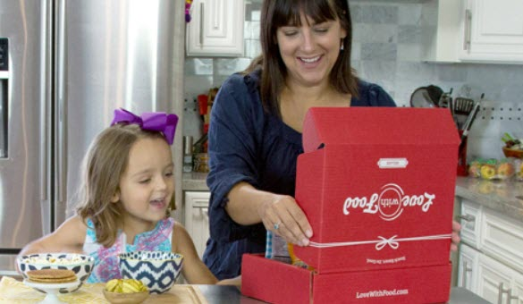 A mother and daughter opening a snack box