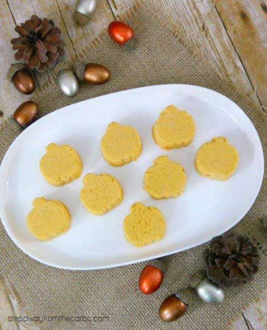 Pumpkin shaped fat bombs on an oval white plate