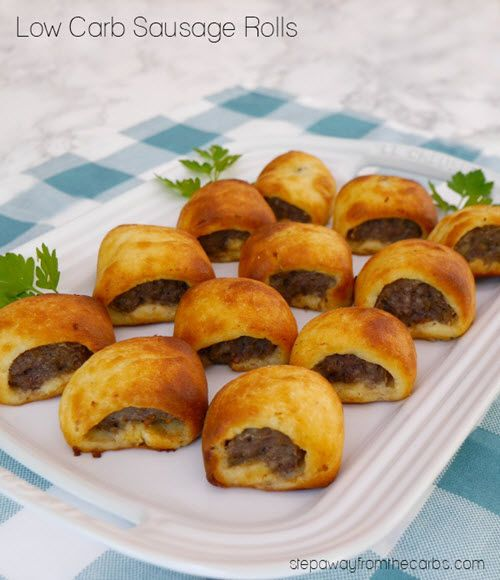 A selection of sausage rolls on a white plate