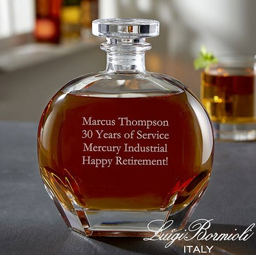 A round decanter with 4 lines of engraved text