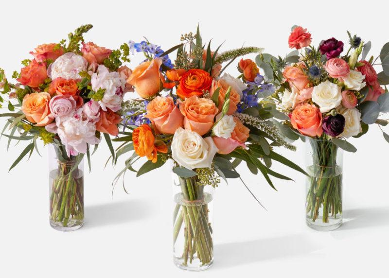Luxe Subscription from Urban Stems showing three bouquets of flowers in glass vases