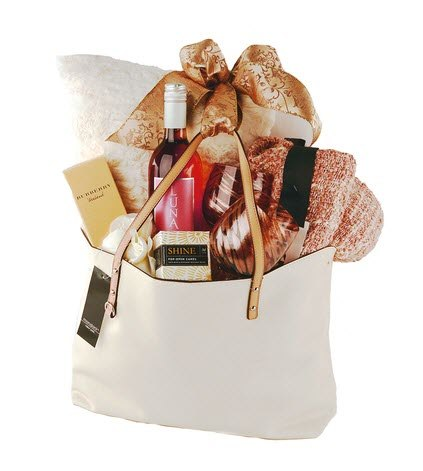 Tote bag with red wine and luxury items