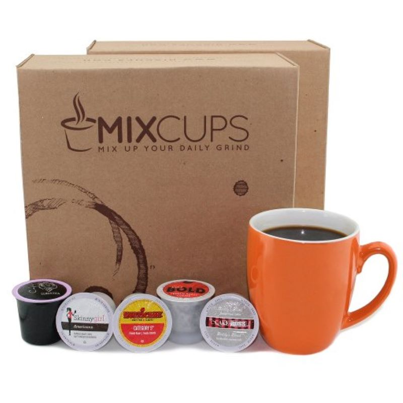Two MixCups boxes that say mixcups, Two MixCups boxes that say mixcups mix up your daily grind with five k cups in front of the box and an orange coffee cup off to the side.