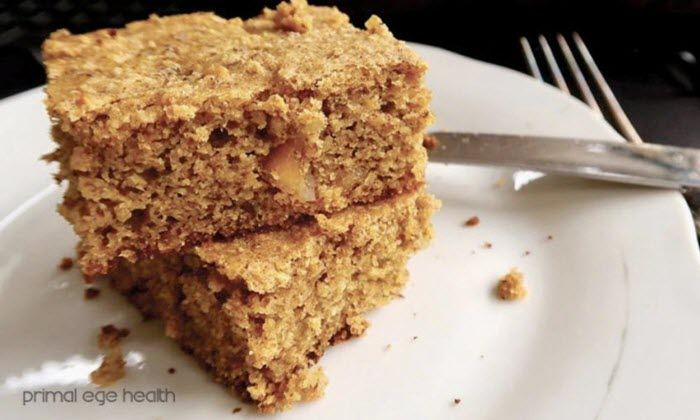 A white plate with two pieces of coffee cake