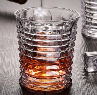An accordion-shaped whiskey glass