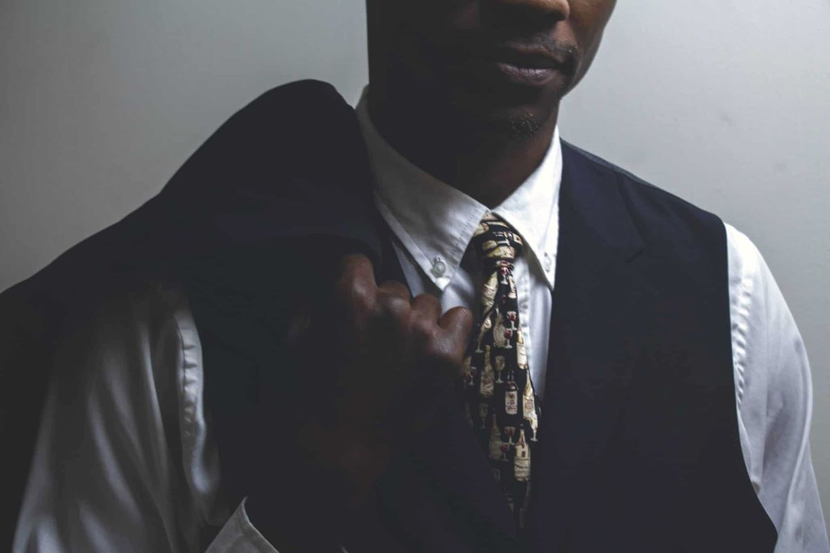 Tie of the month club - Man in vest tie and button down holding suit coat over his shoulder
