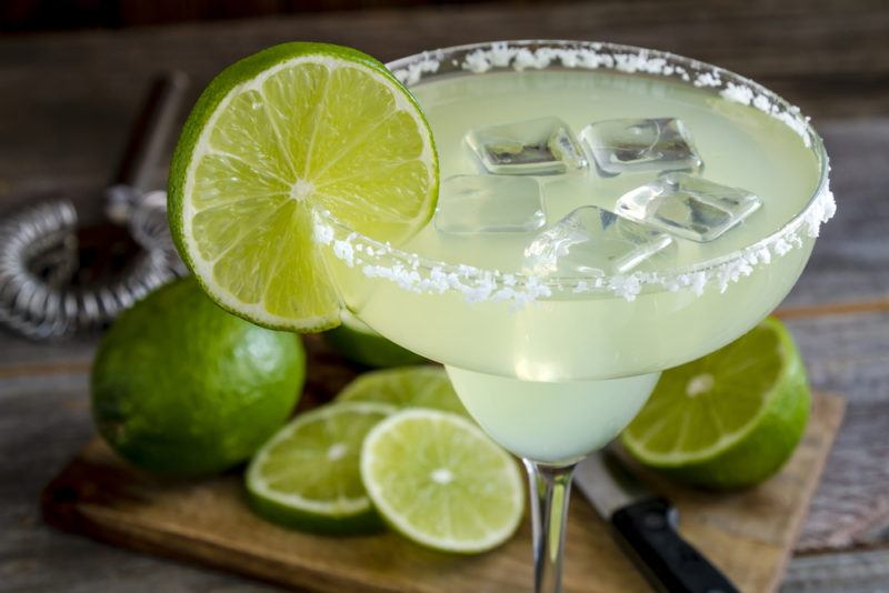 A green margarita with ice in a salt rimmed glass