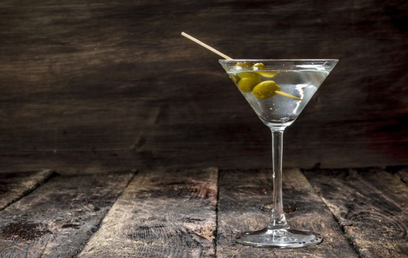 A vodka martini with olives as a garnish