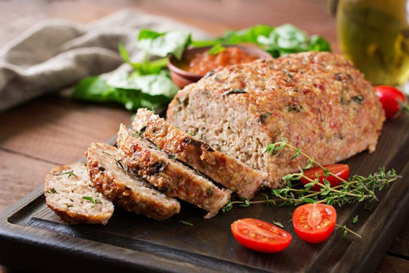 Sliced meatloaf on a black table