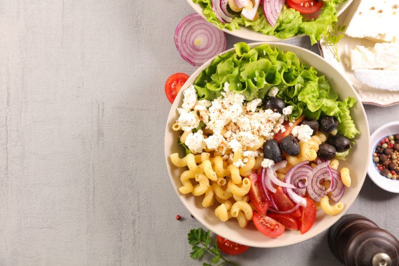 A white bowl with Mediterranean ingredients