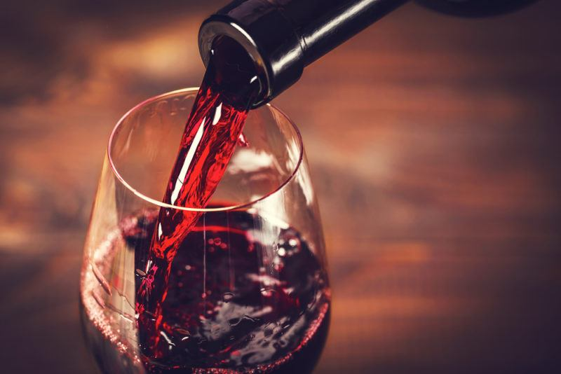 Merlot being poured into a glass from a bottle